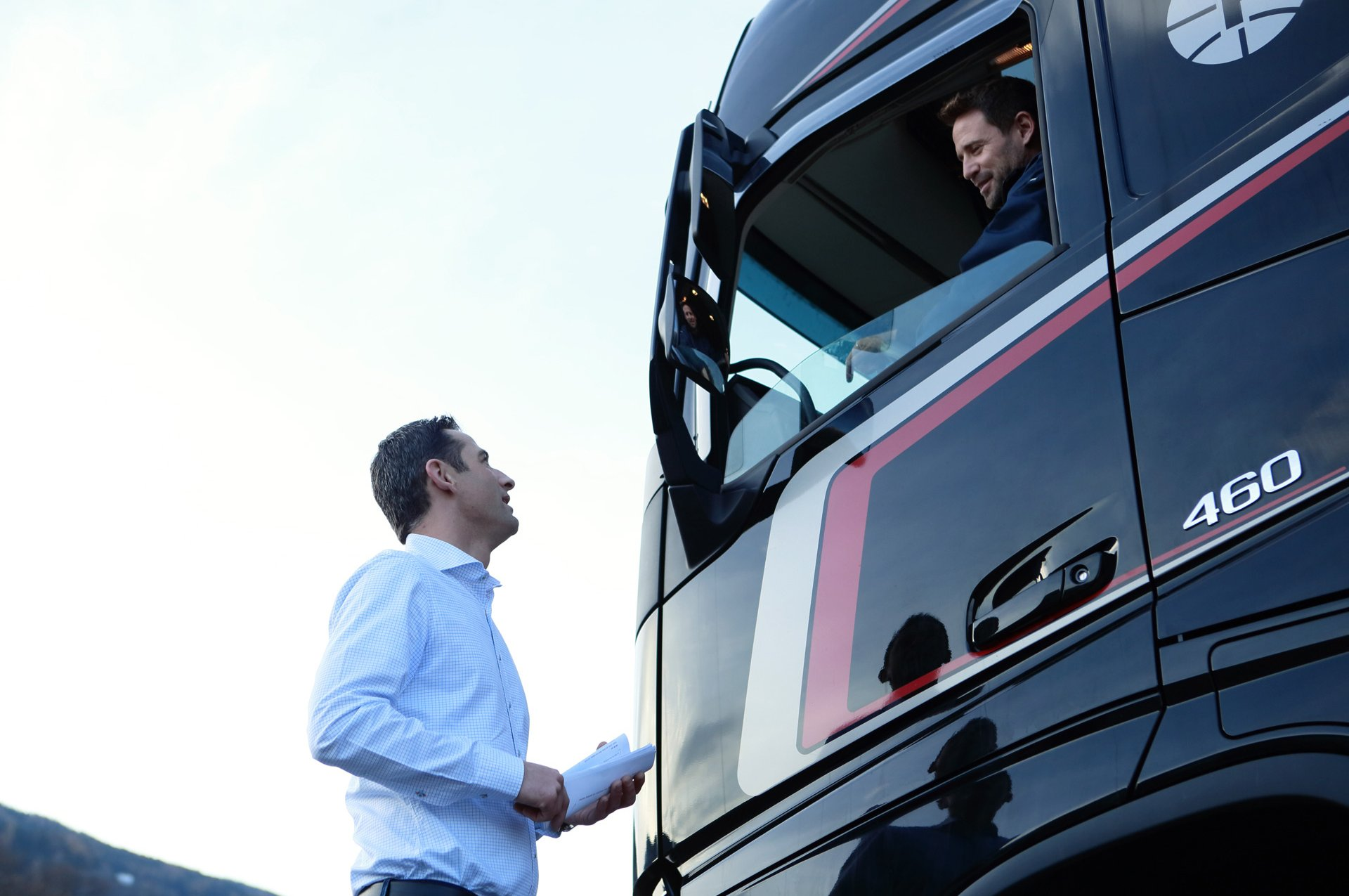 Andreas Fluckinger talking to a truck driver